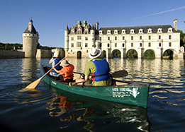 Canoe on the loire river and pass under the arches of chenonceau castle